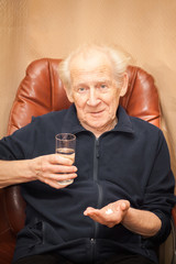 surprised old man with pills