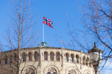 Norwegian flag on parliament building rooftop