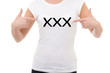 woman showing t-shirt with xxx text isolated on white
