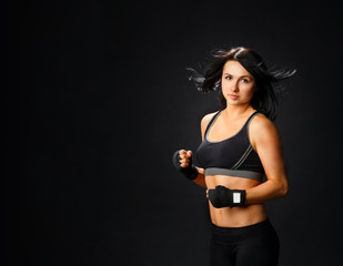 Young fitness woman in gym gloves