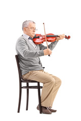 Senior musician playing a violin