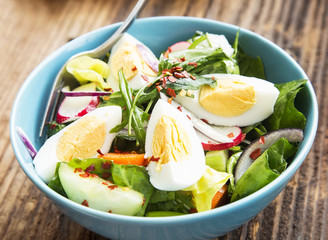 Healthy Vegetable Salad with Boiled Eggs and Chili Flakes