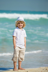Adorable little boy   at the beach during summer vacation