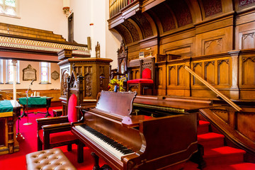 Piano by Altar in Old Church