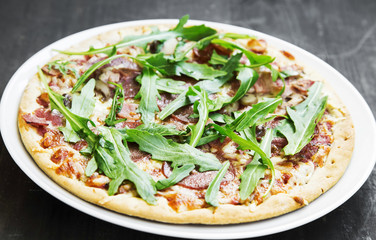 Pizza with Fresh Arugula Leaves