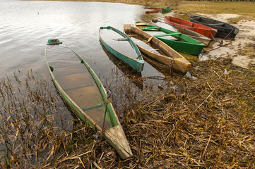 Colored fishing boats on the lake