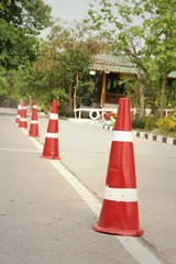 orange traffic cones on the road at the park.
