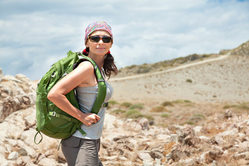 Adult brunette woman hiking and backpacking