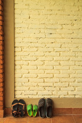 Shoes against the wall