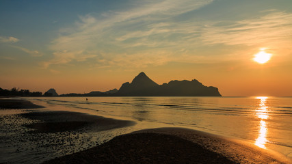 Natural scene at Ao Manow beach in sunrise time. Process color.