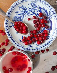 Cranberry tea and berries in saucer on a tray