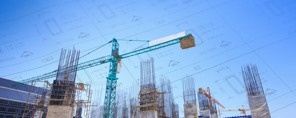 Building crane and construction site under   blue sky