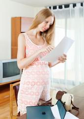 pregnancy woman looking paper