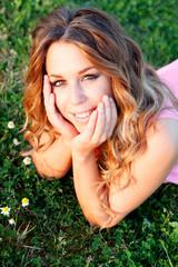 Pretty blonde woman in a field full of flowers