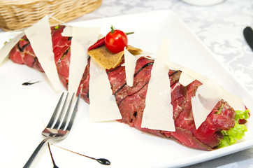 carpaccio at a restaurant on a white background