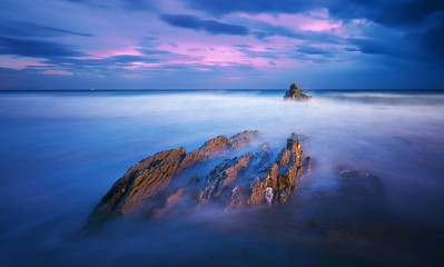 rock in Sopelana beach at night