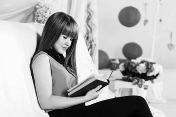 Beautiful little girl reading book