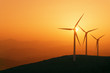 wind turbines silhouette on mountain at sunset - 81865458