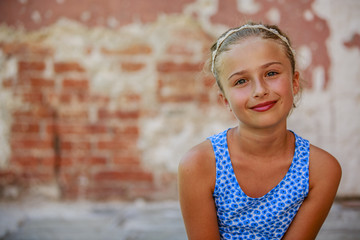 Portrait of happy beautiful young girl in summer dress