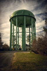 Old Style Green Water Tower
