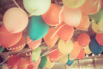 Colorful balloons floating on the ceiling of a party in vintage