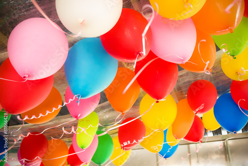Leinwanddruck Bild Colorful balloons floating on the ceiling of a party