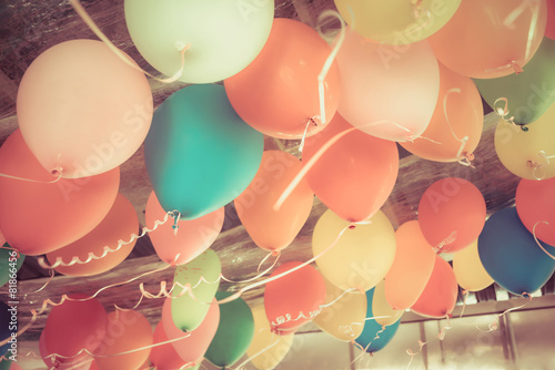 Leinwandbild Motiv Colorful balloons floating on the ceiling of a party in vintage