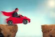 Leinwanddruck Bild - man in a car jumping a ravine