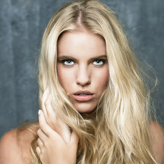 Portrait of a beautiful blonde girl with luxuriant hair