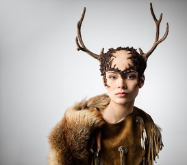 Mythical turnskin woman with deer antlers