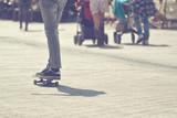 Skateboarder Riding Skateboard at City Street Pavement