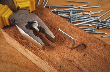 pliers and nail