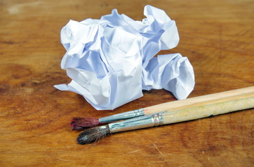 Crumbled paper and paint brushes