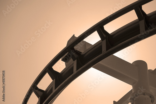 canvas print picture Roller coaster steel structure track in sepia.
