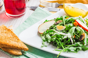 fresh salad with arugula, quail eggs, capers and apple