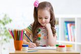 Fototapety Cute little preschooler child drawing at home