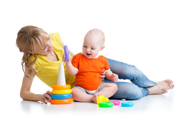 baby boy and mother play together with toy