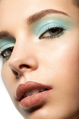 beautiful makeup closeup with blue eye shadow
