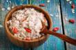 Leinwandbild Motiv oatmeal with berries goji