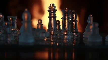 Glass Chess Figures in Front of the Fire
