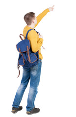 Back view of  pointing young men with backpack.