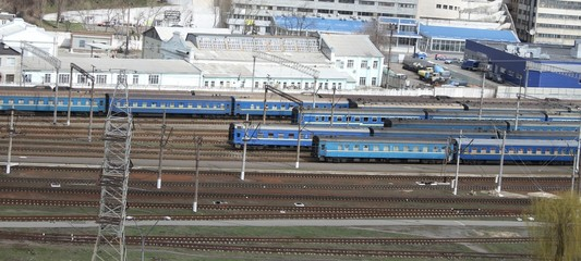Trains waiting passengers at railway station
