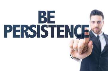 Business man pointing the text: Be Persistence
