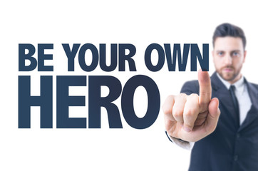 Business man pointing the text: Be Your Own Hero