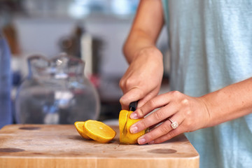 woman cutting lemon