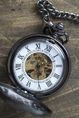 pocket watch on rustic wooden background