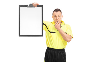 Angry football referee holding a clipboard