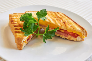 Grilled panini sandwiches stuffed with ham and cheese