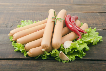 Close up of sausage and fresh vegetables