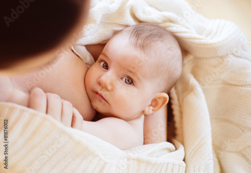 Mother breastfeeding her little baby girl in her arms - 81876002